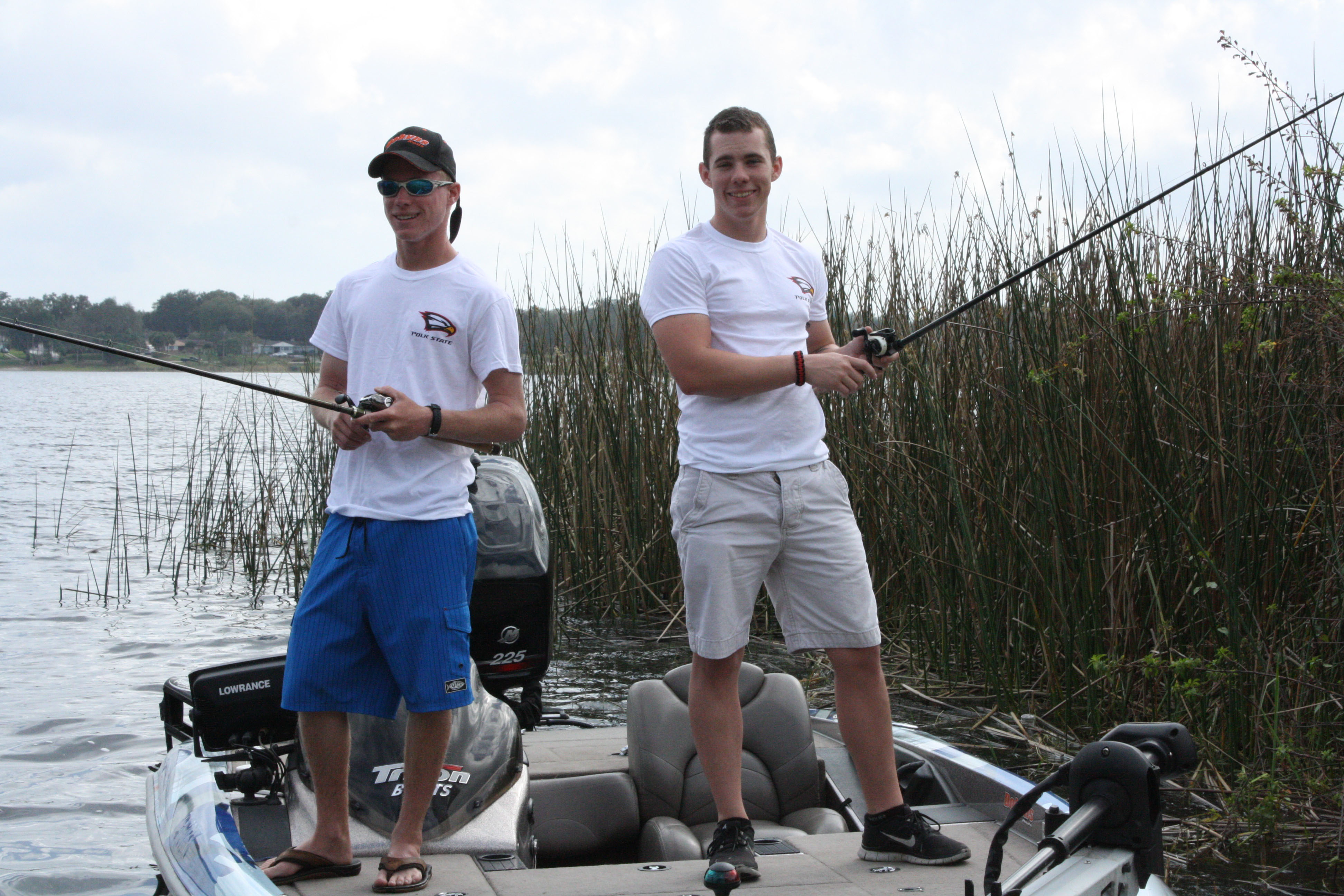 Polk State College Bass Fishing Team members Forrest Greenfield (L) and Austin Bell are pictured on Lake Elbert in Winter Haven.
