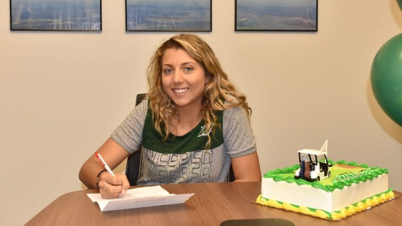 Breana Thompson signs a scholarship to play golf at Webber University.