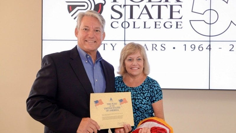 U.S. Congressman Dennis Ross visited the Polk State Clear Springs Advanced Technology Center on Wednesday to present a flag flown in honor of the building to President Eileen Holden.
