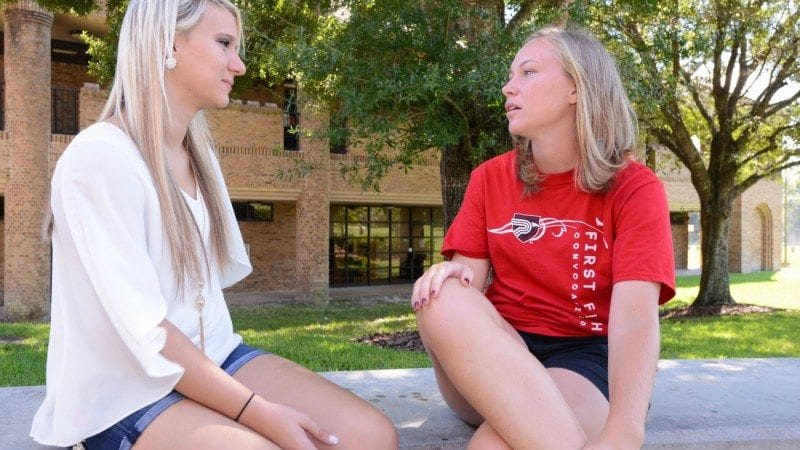 Meghan Flaherty (R) speaks with one of her mentees, Sommer Leavens. Flaherty is participating in the College's First Flight mentor program for freshmen.