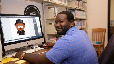 Jarrod Jones, reference and instruction librarian at Polk State Winter Haven, designs characters for the comic book he created to help students understand the library's resources and services.