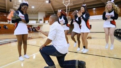 During a recent Polk State basketball game, Esteban Jimenez proposed to Polk State cheerleader Ahmeya Woods. She said yes.