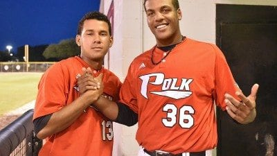 Former Polk State baseball players Maikor Mora (L) and Jordan Gurrero, who were selected in this year's MLB draft, pose in the dug out during an April 18 game. Casey Schroeder, not pictured, was also drafted.