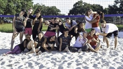Polk State volleyball players and coaches enjoy the new sand volleyball court on the Winter Haven campus.