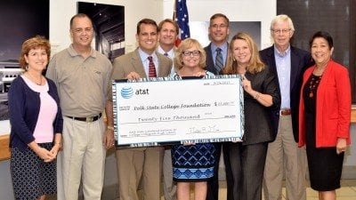 AT&T presented the Polk State College Foundation with a $25,000 gift to support Polk State Lakeland Gateway to College Collegiate High School during Monday's District Board of Trustees meeting. From left, Polk State College Foundation Treasurer Bonnie Parker, Polk State Trustee Ricardo Garcia, AT&T Regional Director Matt Mucci, Trustee Mark Turner, Polk State President Eileen Holden, Trustees Greg Littleton, Teresa Martinez, Dan Dorrell and Linda Pilkington.