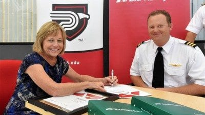 Polk State President Eileen Holden and ExpressJet First Officer and Pilot Recruiter Jared Allison celebrated a new partnership on Tuesday that will give Aerospace students access to ExpressJet mentors and preferential hiring benefits.
