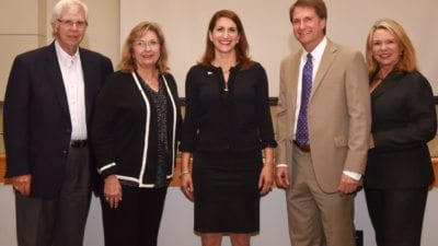 Polk State College President Angela Garcia Falconetti poses with the District Board of Trustees during her first DBOT meeting August 28.