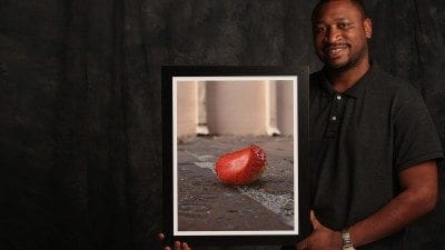 Jamie Lisbon with the photograph that won First Place at the 2015 Strawberry Festival Photography Contest.