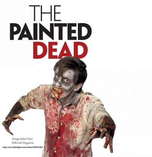 """Image of a male zombie with the text """"The Painted Dead"""" above it. Text credits source to """"Polk Life Magazine"""""""