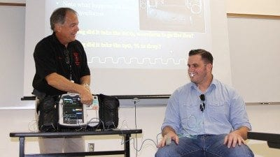 Polk State EMS Director Don Guillette (L) demonstrates nasal capnography on Derek McBrayer during Polk County Fire Rescue's EMS Week at Polk State Winter Haven.