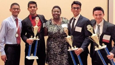 From left, Allen Oommen, Glen Abraham, FBLA adviser Patrice Thigpen, Sean Chauhan and Wade Weston.