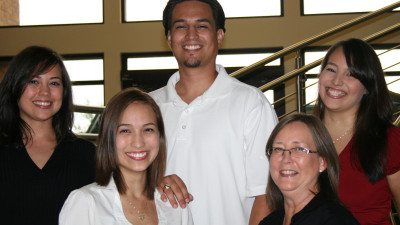 Back row from left, Cheryl Tanner, Eric Huron, Desiree Huron. Front row from left, Angela Huron and Treasure Huron. Treasure and each of her four children studied at Polk State College.