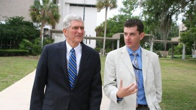 U.S. Rep. Daniel Webster (L) tours Polk State Winter Haven with student Ryan Darley.