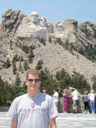 Jason Selfridge showed off his Polk State T-shirt at Mount Rushmore earlier this summer.