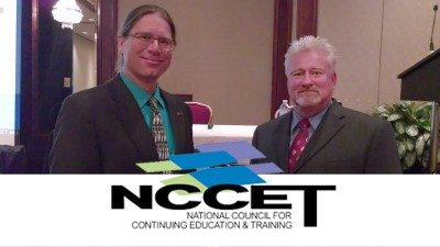 Polk State's Eric Roe (L) and Howard Drake accepted the NCCET's Exemplary Program Award earlier this month. The award recognized ETAM, an innovative training program for manufacturing workers.