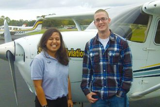 Polk State Aerospace student Tanner Atkinson, left, is the first student in the program to fly. He is pictured here with Prachi Shah, his SunState Aviation flight instructor, just moments after the flight.
