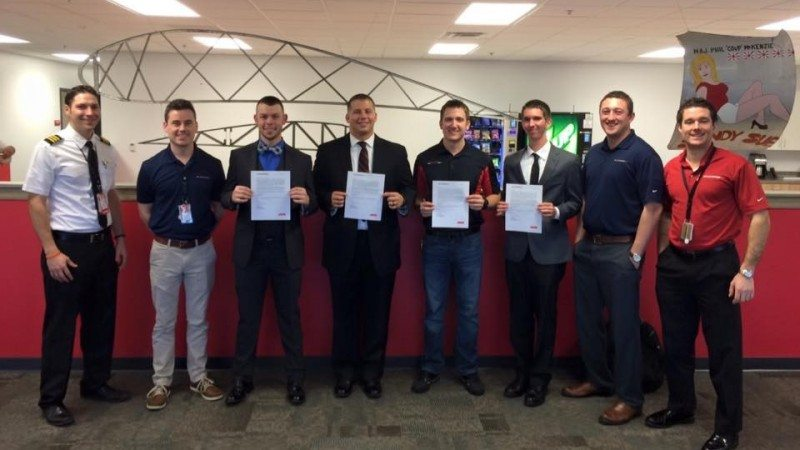 From left, ExpressJet First Officer Dano Pebler, Captain Joey Cook, Polk State Aerospace students Aaron Poidevin, Eric Martin, John Reichert, Nathan Calhoun, ExpressJet First Officer Peter Ryan, and First Officer Jack Eastes. A total of seven Polk State Aerospace students were extended conditional job offers during ExpressJet's first hiring visit to the College last week.