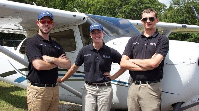 From left, Polk State Aerospace students Aaron Poindevin, Karissa Strickland and Grant Guthrie are participating in drone visibility research the College is conducting in partnership with Turin Aviation Group, Pasco County and Oklahoma State University.