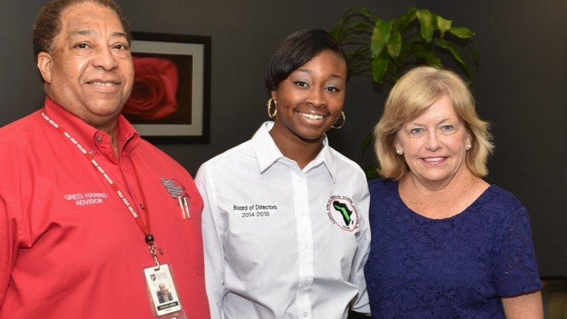 From left, Polk State Psychology Professor Greg Harris, Kailah Ruffen, and Polk State President Eileen Holden.