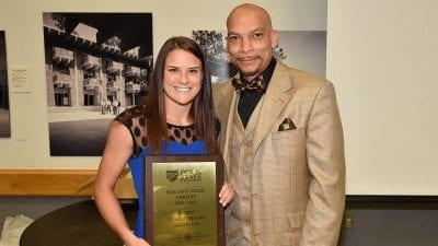 On behalf of the soccer team, Sarah McKinney accepts Academic Team of the Year Award from Vice President for Student Services Reggie Webb.