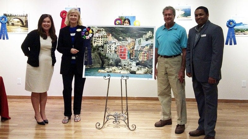 Polk State's Kim Simpson, Anne R. Moore, winning photographer Ron Whitney and Osubi Craig. Whitney's photograph, and other winners of the Capturing Cultures contest, will be on display at the Polk State Lake Wales Arts Center until Dec. 10.