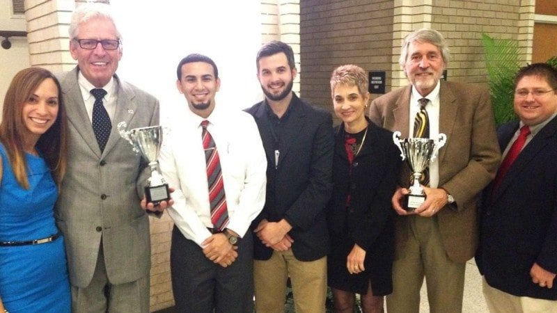Celebrating the Polk State Corporate College's wins at the 5th Annual Champions Cup Business & Industry Awards last week in Bartow were, from left: Professional Development Institute Program Coordinator Nyrka Riskin; Polk State Corporate College Director Rob Clancey; Polk State Corporate College Event Coordinator Samuel Serrano; Advanced Manufacturing Institute Interim Director Wyatt Dube; IT Institute Program Coordinator Mary Ellen Schmitt; Polk State Lakeland Provost Stephen Hull; and Advanced Manufacturing Institute Program Coordinator Sam Hale.