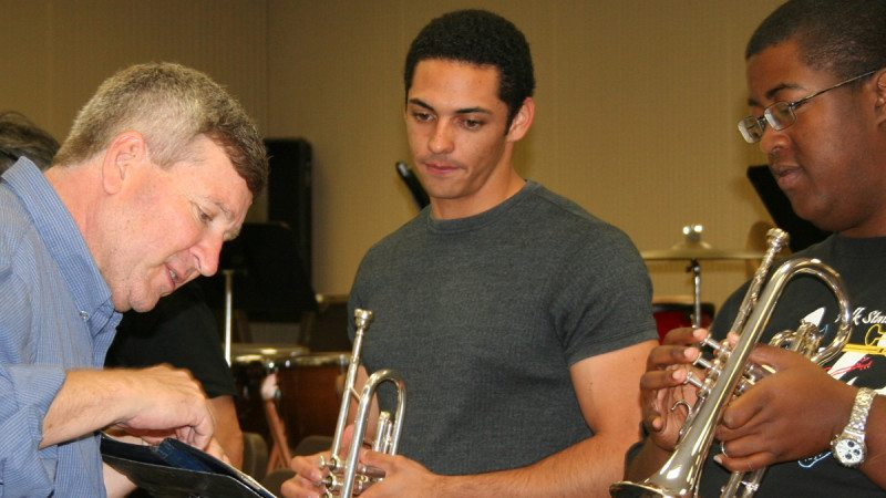 Polk State Music Professor Chris Sharp, left, has published hundreds of compositions.