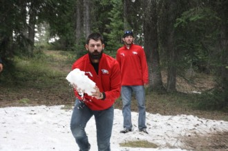 Chris Waltermire (RHP) lifts a giant snowball during the team's Sunday tour of Grand Mesa.
