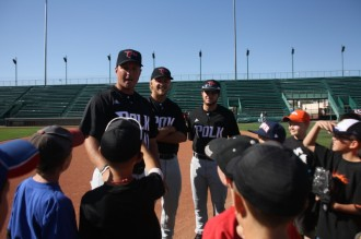 Polk State Baseball Head Coach Al Corbeil and players Conor Szczerba and Colt Hankamer (L-R) instruct children on making double-plays during the 12th-annual JuCo Youth Clinic on Thursday in Grand Junction, Colo.