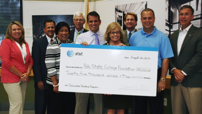 The Polk State Foundation on Monday recognized AT&T for a $25,000 grant that allowed more students to participate in Technobots, a summer robotics program. From left, Trustee Teresa Martinez, Polk State Foundation Treasurer Kevin Ashley, Trustee Chair Linda Pilkington, Trustee Dan Dorrell, AT&T Regional Director Matt Mucci, Polk State President Eileen Holden, and Trustees Mark G. Turner, Ricardo Garcia and Gregory Littleton.