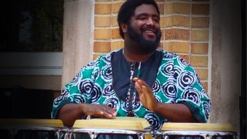 Percussionist Weedie Braimah entertains the audience outside the Polk State JD Alexander Center during a free concert Wednesday.