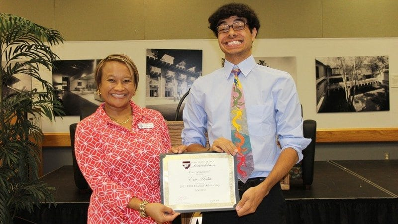 Polk State English Professor and ELITE Class VII Ambassador Orathai Northern presented the inaugural ELITE Legacy Scholarship to Eric Ardito during last week's ELITE Ambassadors Luncheon.