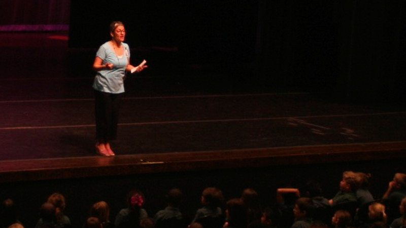 "Polk State Theatre Adjunct professor Ilene Fins addresses more than 600 second-graders prior to the start of ""All Kids Read with Polk State"" on Thursday."
