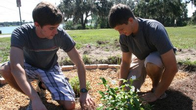 Students Andy Wooddell (L) and Frank Portlock were among two-dozen students who recently planted two rain gardens on Polk State's Winter Haven campus. The gardening project is one that will be highlighted in a Florida Campus Compact guide for service-learning and STEM education.