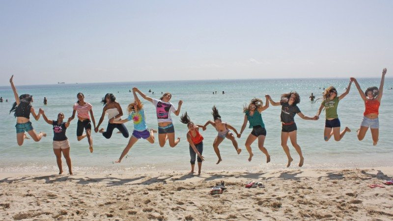 The Polk State College volleyball team shows its togetherness on Miami Beach before a tournament in September.