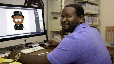Jarrod Jones, newly hired full-time reference librarian at Polk State Winter Haven, creates characters for a comic book that explains library procedures and resources to students.