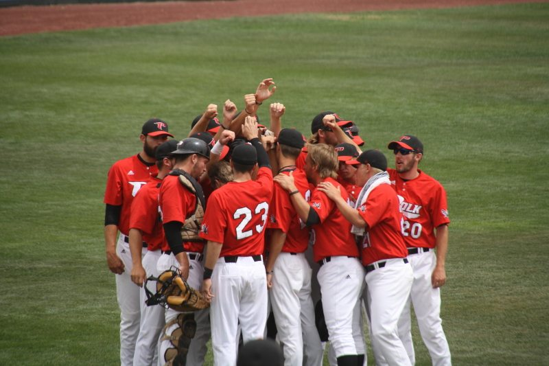 The Polk State Eagles huddle before taking the field against Western Nevada during the first round of the NJCAA JuCo World Series.