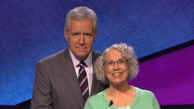 "Retired Polk State professor Kathy Riley won $10,400 while competing on ""Jeopardy!"" earlier this month. She has donated $1,000 of her winnings to the Polk State College Foundation. Here, she is pictured with ""Jeopardy!"""