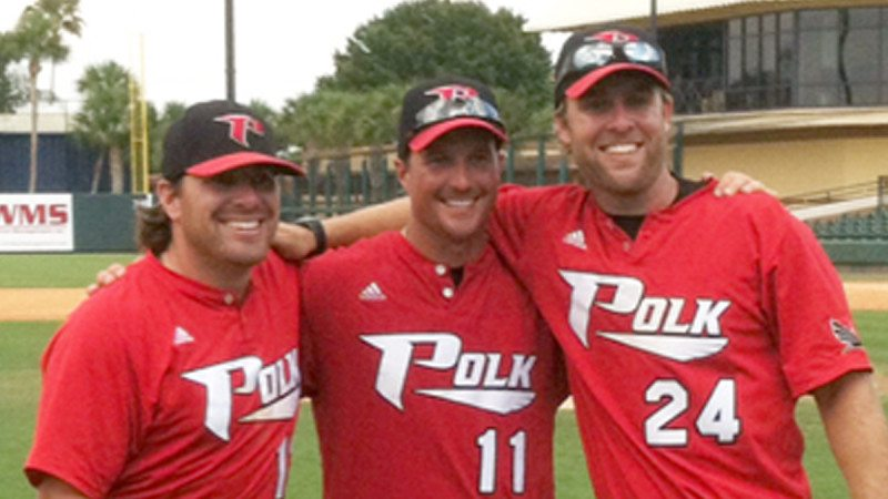 Coaches Cook, Corbeil and Martin (L-R), moments after securing Polk's first World Series berth.