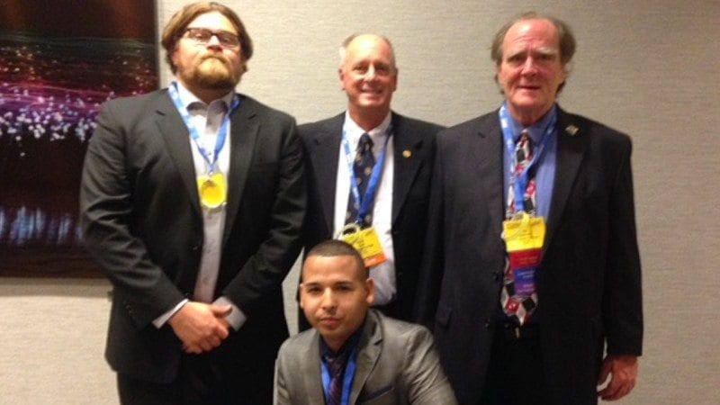 Polk State's Phi Beta Lambda chapter brought home several honors from the national conference. Front row, Hector Santa. Back row from left, Kyle Cox, adviser and Business Professor Herb Nold and Jim Harmon.