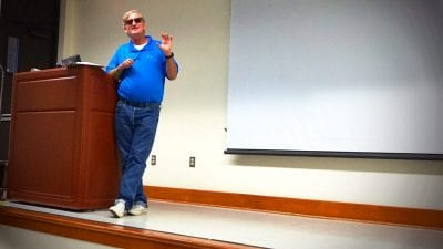 Florida Southern College Associate Professor of Political Science R. Bruce Anderson speaks to Polk State Lakeland Collegiate High School students on Tuesday.