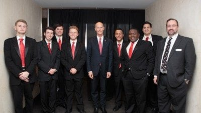 Polk State's Jazz Society performed during Polk County Day last week in Tallahassee. From left, Ian Albritton, Brendan Nagy, Trenton Moser, Luke Wilmoth, Gov. Rick Scott, Alex Irizarry, Joseph Lewis, Clement Dutheil, and Director of Bands Donald West.