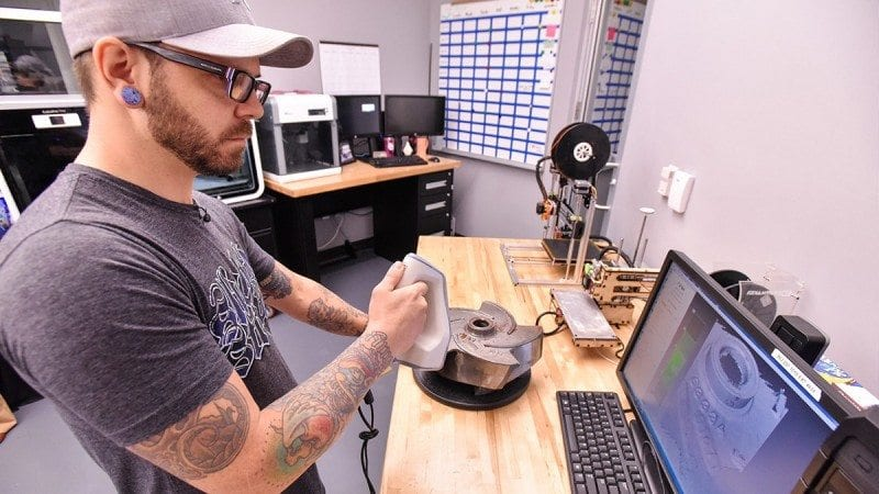Charles Nixon, manager of Polk State's 3D print shop, demonstrates some of the technology students will use in the 3D printing classes now being offered at the Polk State Clear Springs Advanced Technology Center.