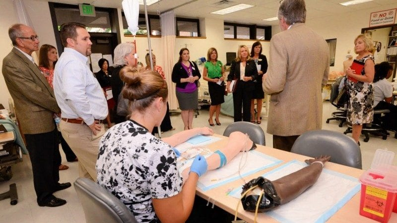 Attendees of Polk State College's Legislative Tour learn about the Nursing program during their tour of the Lakeland campus on Wednesday.