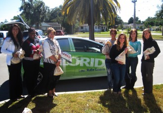 Polk State Chain of Lakes Collegiate High School's Leadership Cadre recently raised $947 for good causes through its Penny Harvest. From left are Jeanette Wallace and Bridget Dewdney from MIDFLORIDA, Polk State Chain of Lakes Director Bridget Fetter, students Laci Jackson, Michelle Luckett, Hailey Stinchcomb, Polk State Chain of Lakes student project chairs, and Polk State Service Learning Coordinator Sarah Hoiland.