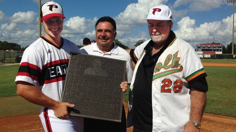 Polk State honored Bing Tyus, former baseball coach and current athletic director, on Saturday during a ceremony to dedicate Bing Tyus Yard. From left, Polk State Baseball Coach Al Corbeil, Polk State Athletics benefactor Bob Georges, and Bing Tyus.
